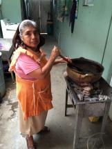 Estela cooks the mole.