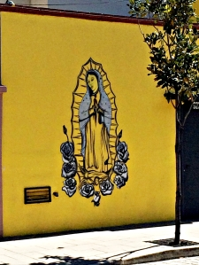 Guadalupe on a wall in Oaxaca